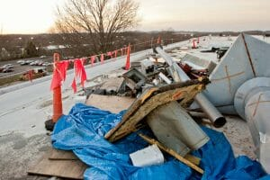 debris from a storm scattered across commercial roof