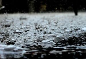 rain falling onto pavement and splashing up