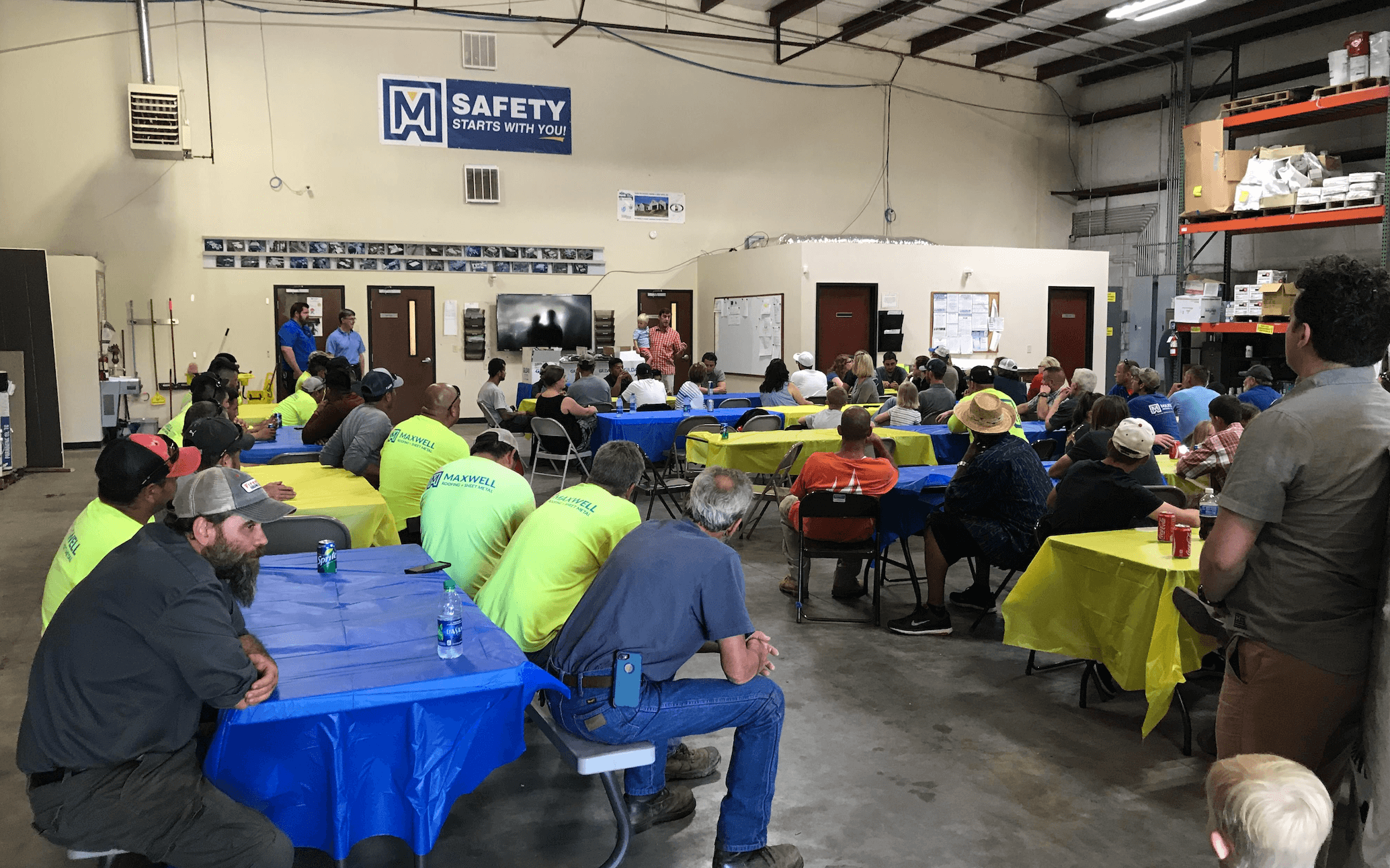 employees celebrating at the Maxwell Roofing office for the employee summer party