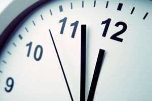 close up shot of a black and white clock set to 11:52