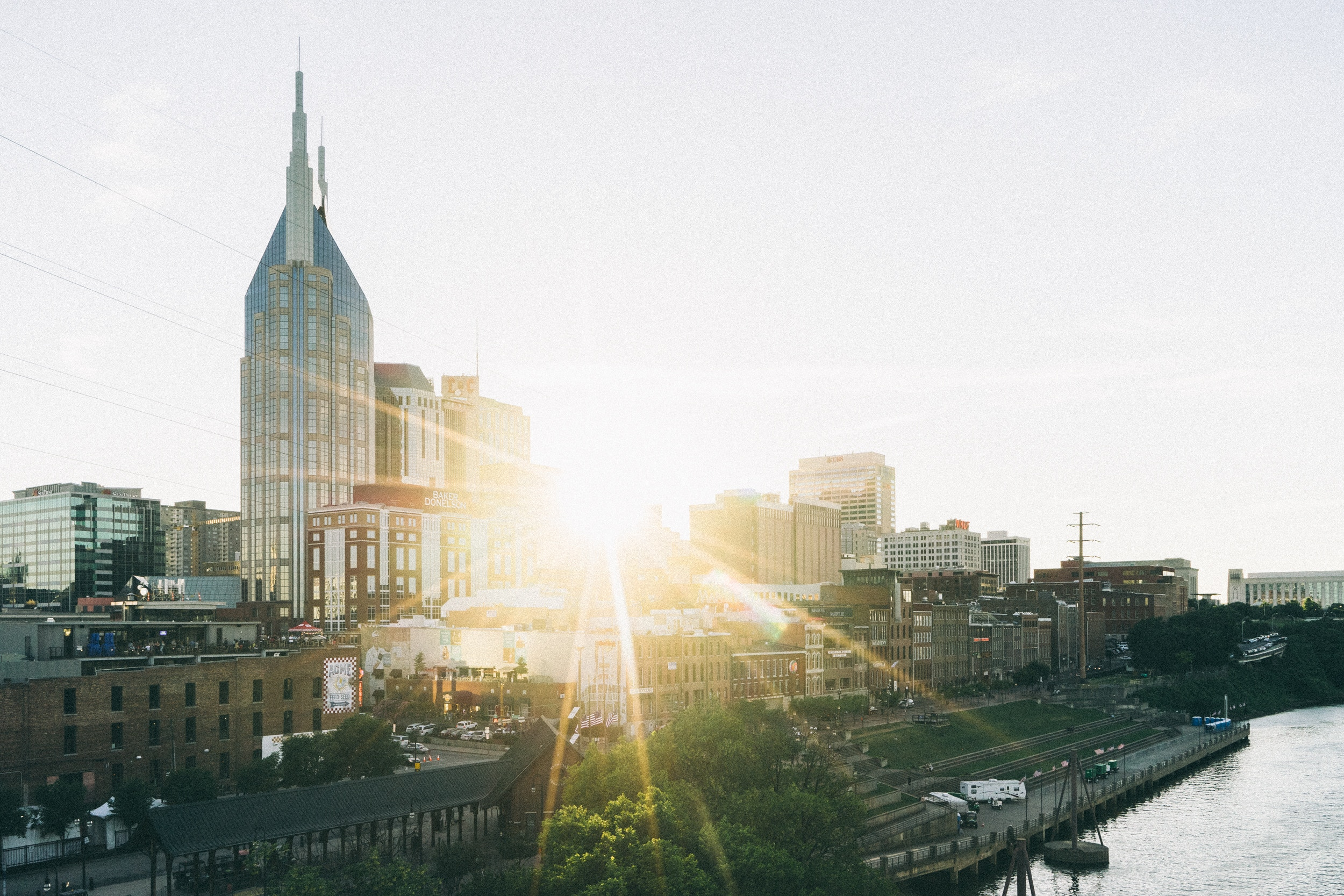 nashville skyline with sun beaming through the buildings and the at&t building stick out above all other buildings