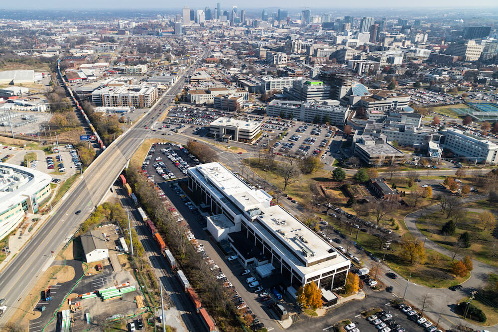 aerial shot of nashville with an emphasis on the HCA Healthcare building's roof