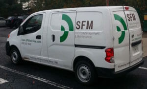 SFM, School Facility Management, service van with green logo on display