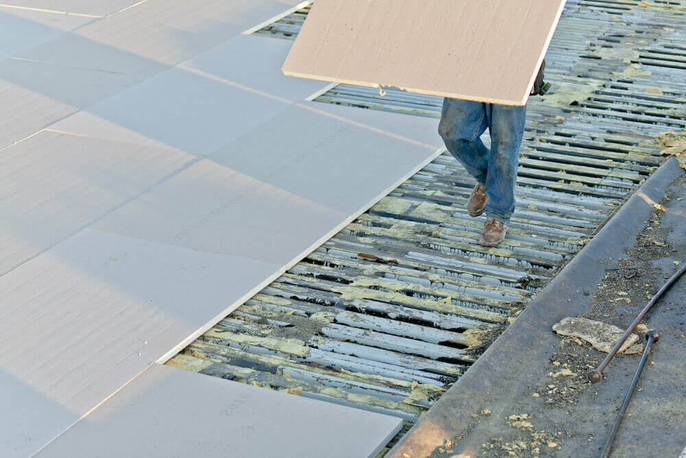 in process of adding layers on a commercial building re-roofing project