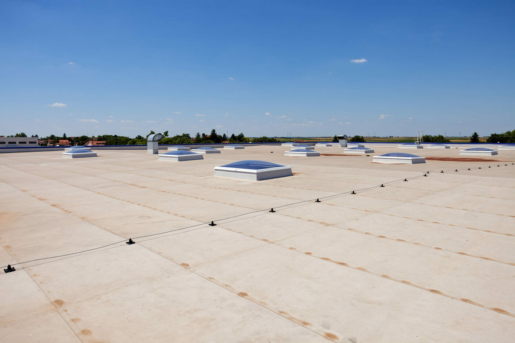 skylights scattered across commercial roof