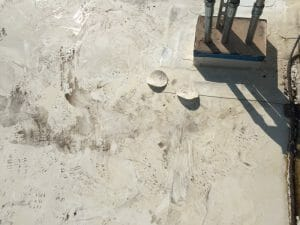water on commercial roof from a leak