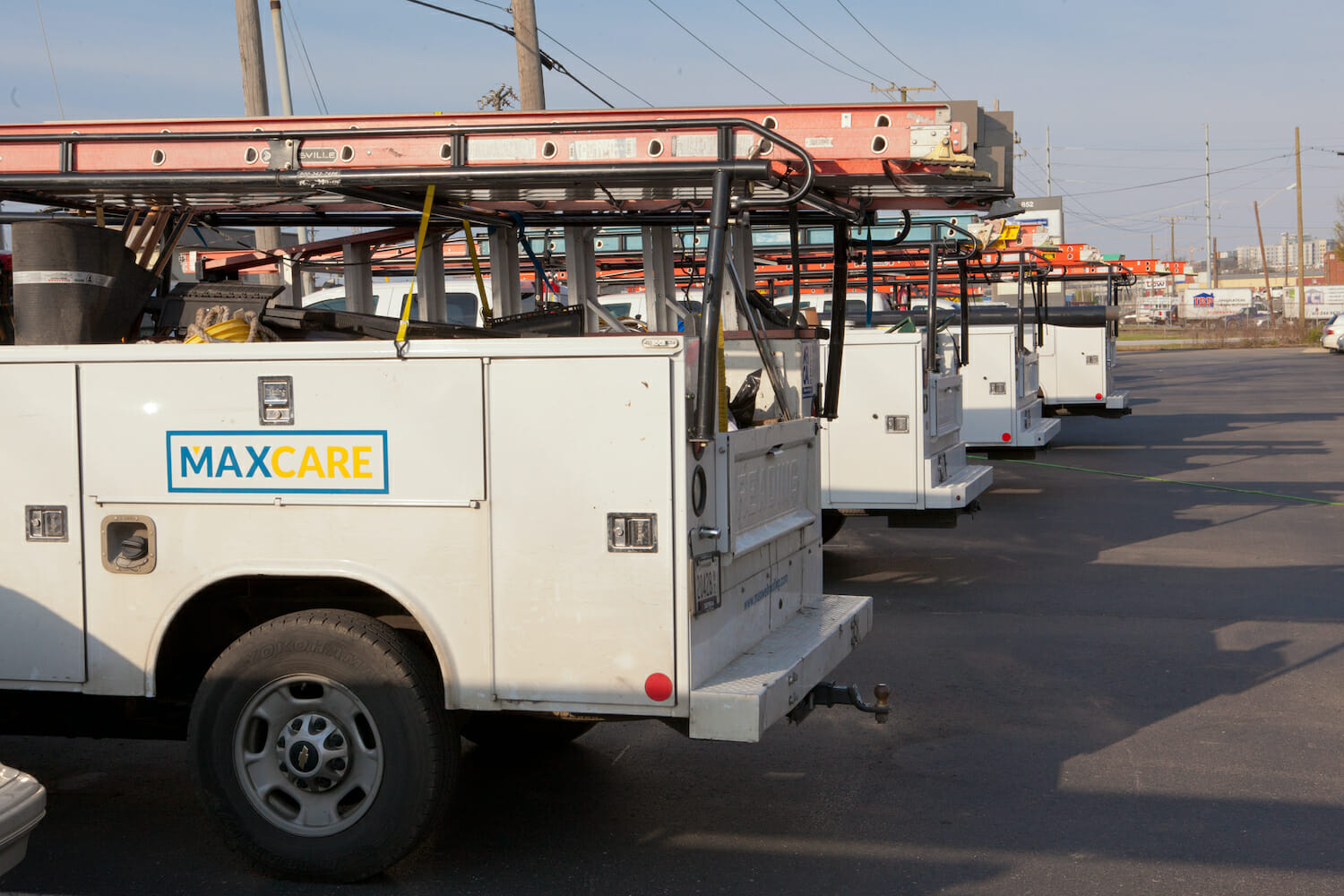 four MAXCare service trucks parked in a row