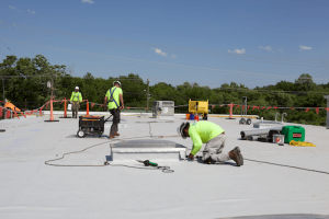 maxwell roofers installing curb on commercial roof