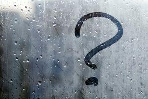 Autumn rain, the inscription on the sweaty glass with question mark
