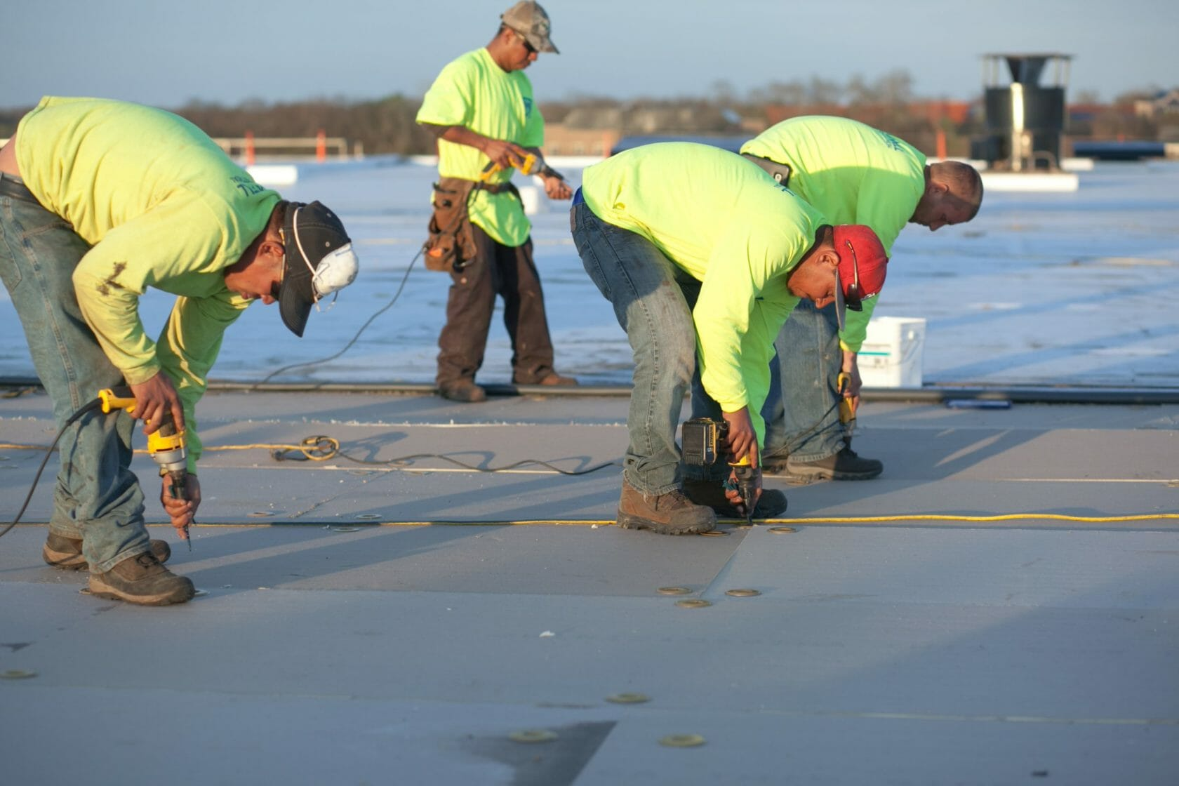 Maxwell Roofing workers repairing a commercial roof
