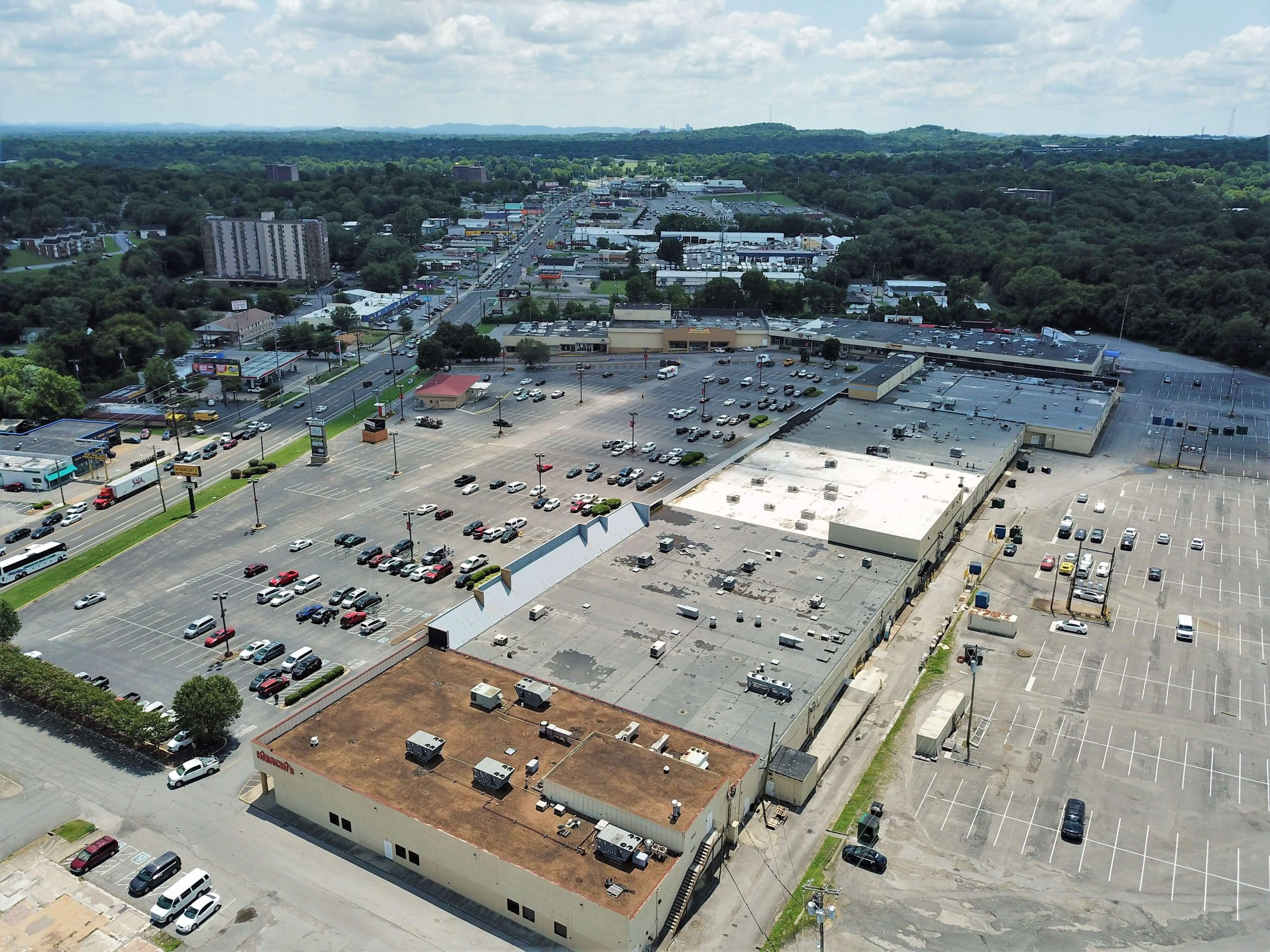 aerial shot of commercial roof with cars in the parking lot
