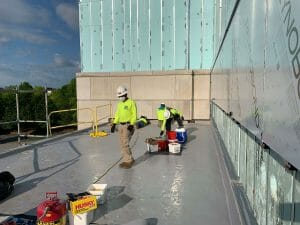 Maxwell monitor service on roof preforming preventative maintenance on a commercial roof